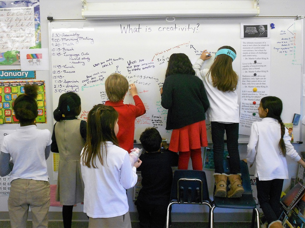 Elementary class writing definitions of creativity on whiteboard