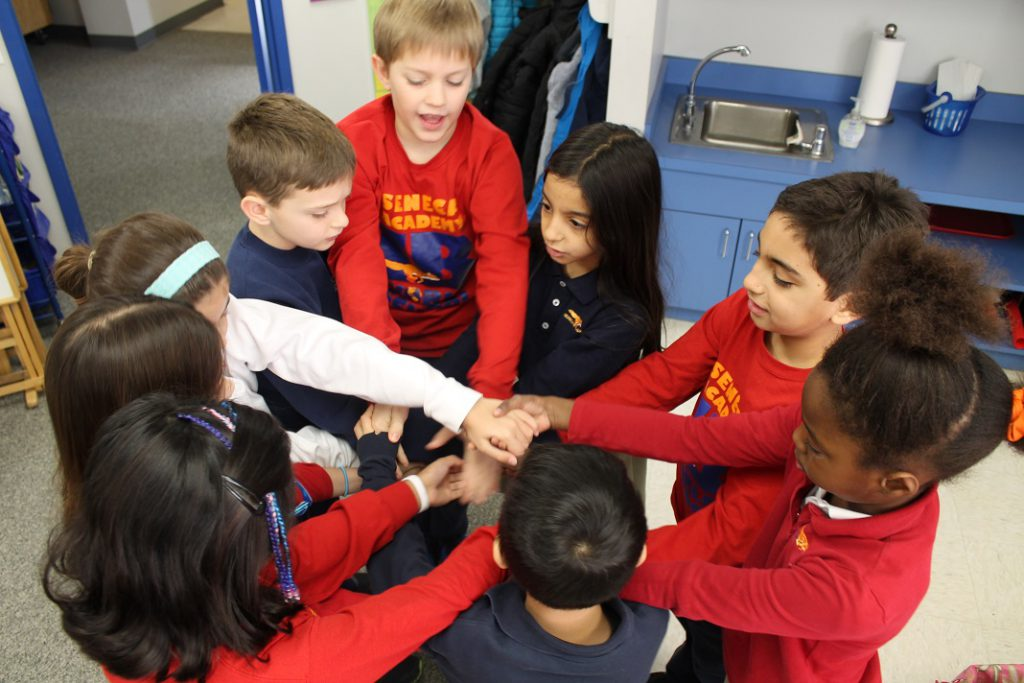 Elementary students untying a human knot in team-building exercise