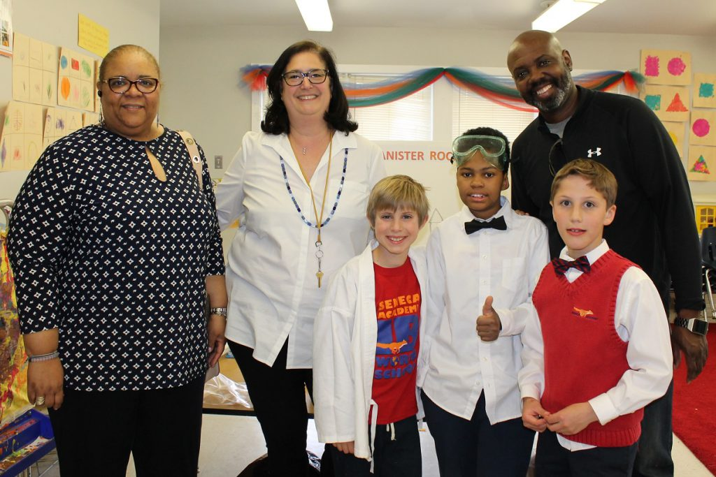 Seneca Academy Board members with elementary students at a STEAM Fair