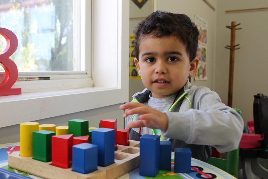Preschooler doing puzzles
