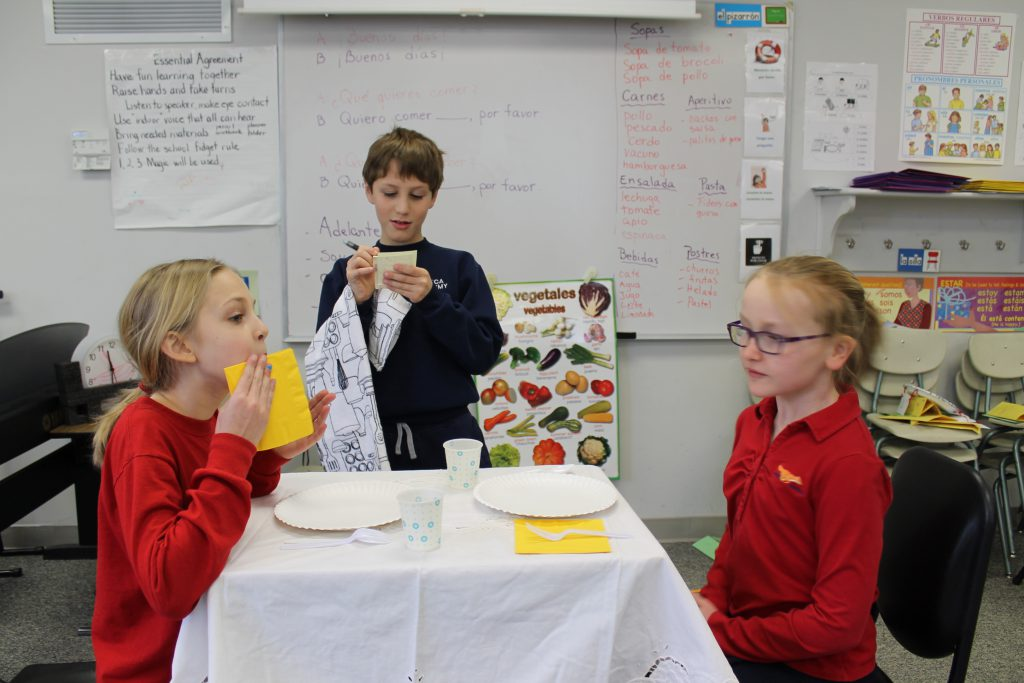 Elementary students learning about Spanish food and menus